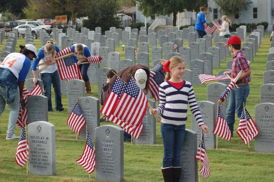 Students and parents from MISD placing flags for the Fifth Annual Flags for Our Heroes. Photo: Submitted