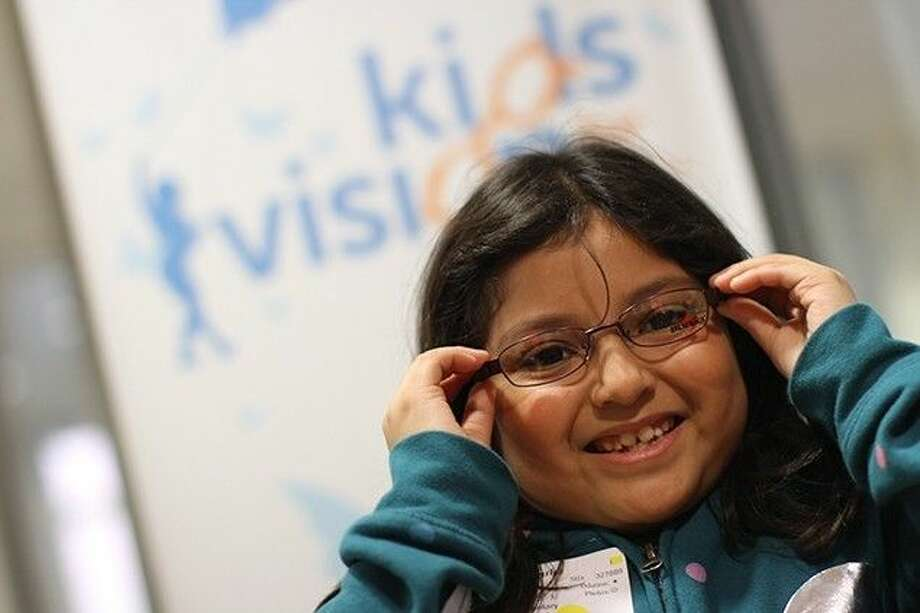 Morales Elementary third grader Samantha Rojas, showed off the new frames she picked out during the annual See to Succeed event at San Jacinto College in Pasadena.