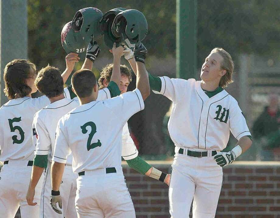 The Woodlands' Mark Doerries (9) celebrates with teammates Hillin Warrren (5), Alex Hale (1) and Colton Wardle (2) after hitting a grand slam in the first inning during a high school baseball game against Lufkin Tuesday. To view or purchase this photo and others like it, visit HCNpics.com. Photo: Jason Fochtman