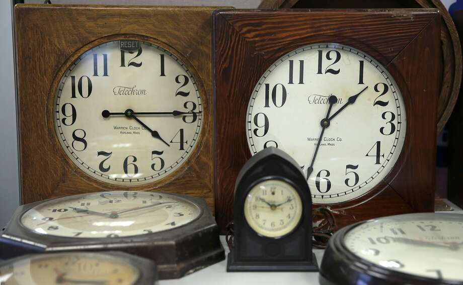 A collection of antique clocks are displayed in the lobby at the Electric Time Company in Medfield, Mass., Thursday, March 10, 2016. Most Americans will lose an hour of sleep this weekend, but gain an hour of evening light for months ahead, as Daylight Saving Time returns this weekend. The time change officially starts Sunday at 2 a.m. local time. (AP Photo/Charles Krupa) Photo: Charles Krupa, AP