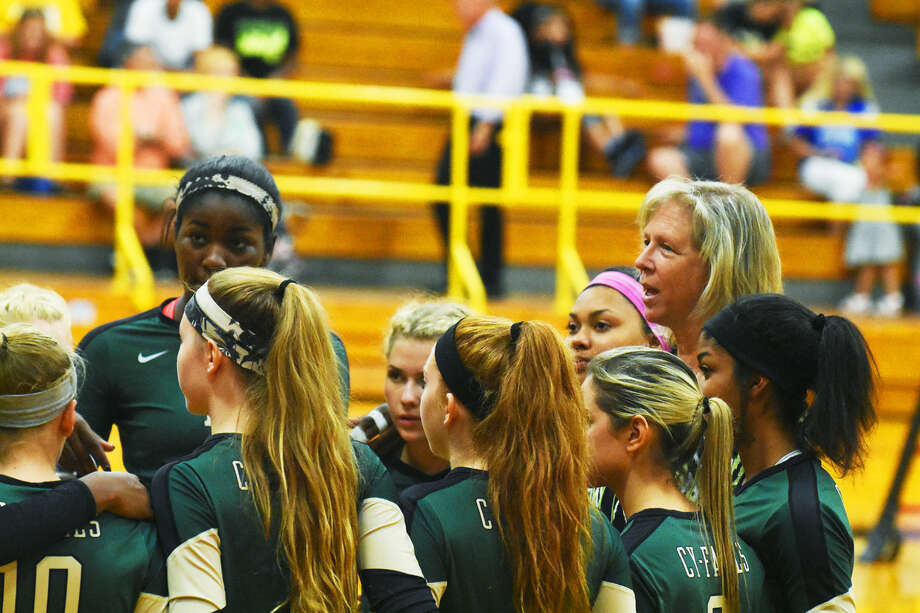 Cypress Falls head coach Kathryn Stephenson coaches during a time out Tuesday. Her Golden Eagles squad improved after a tough first two sets to win the third set 25-23 and fall in the fourth 23-25 after leading through most of the frame. Photo: Tony Gaines