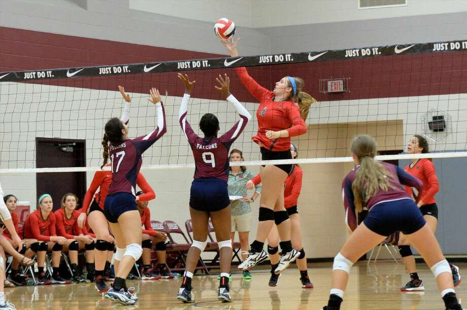 AJ Koele of The Woodlands spikes the ball in Game 2 of their match against Tompkins at the 2016 Nike Volleyball Classic. View additional photos on HCNPics.com