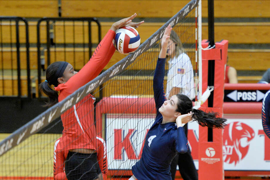 Katy's Jayla Wicker blocks a shot against Lamar during first-round play at the 2016 Nike Volleyball Classic, Aug. 11 at Katy High School. View additional photos at HCNPics.com. Photo: Craig Moseley