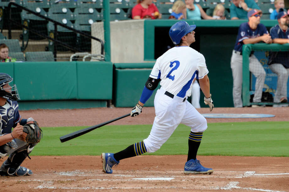 Sugar Land Skeeters infielder Ricky Hague slugs a two-run home run during the first inning against the Somerset Patriots, Aug. 6 at Constellation Field. Hague homered and had four hits in three games at Bridgeport to help the Skeeters sweep the series. Photo: Craig Moseley