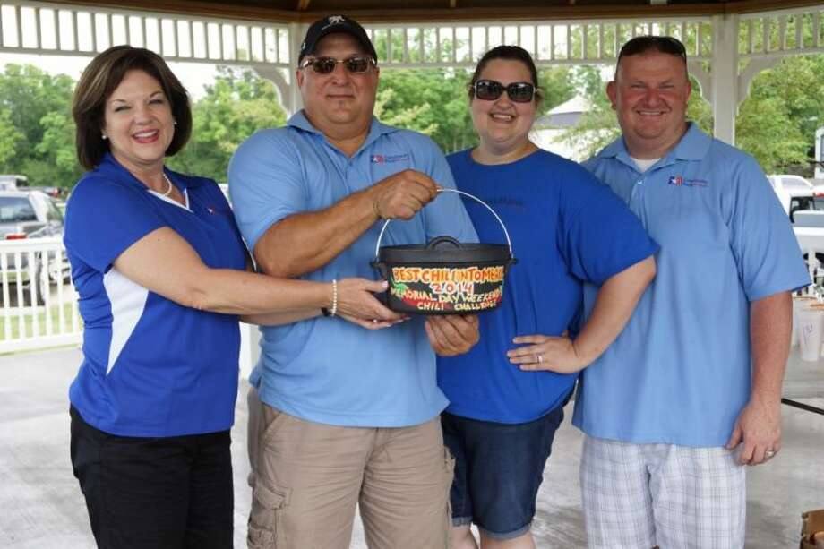 "Team ""Community Bank of Texas"" was awarded the coveted Chili Challenge chili pot for the second time in three years - ""Best Chili in Tomball"". Shown are (l-r) Vicki Clark, Mark Clark, Holly Cook and Ronald Cook."