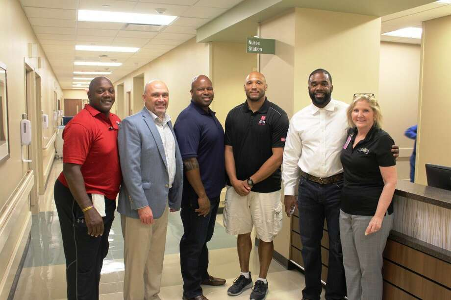 Former NFL players visit with patients and staff at Memorial Hermann Pearland HospitalFrom Left to Right: Former NFL player, Todd McArthur, Shane Crisp, chief operations officer, Memorial Hermann Pearland Hospital, former NFL Player, Jermaine Fazande, Joseph Wesley, president, NFL Players Association Former Players Houston Chapter, former player, Michael Hicks, Cami Rose, director of patient care, Memorial Hermann Pearland Hospital.