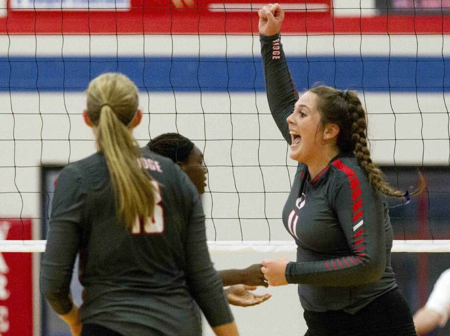 Oak Ridge's Carly Graham celebrates after getting a shot past Willis blockers Gilmore Dobraski and Deseanna Murphy during the third set of a preseason volleyball game Tuesday in Oak Ridge. Go to HCNpics.com to purchase this photo and others like it.