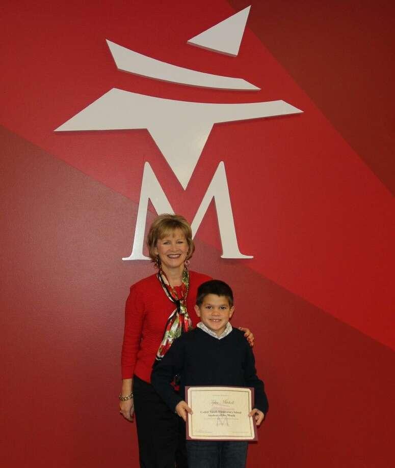 Principal Letty Roman with Tyler Mitchell. Photo: MISD