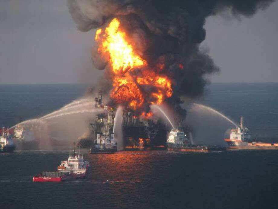 In this April 21, 2010, file image provided by the U.S. Coast Guard, fire boat response crews battle the blazing remnants of the off shore oil rig Deepwater Horizon. / US Coast Guard