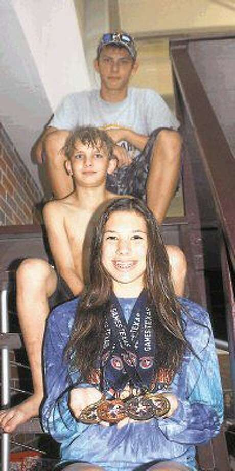 From top to bottom, Cody Merilatt, Harrison Brown and Sierra Moralez represented the Deer Park Seals as they competed at the recent TAAF Games of Texas swim meet in Edinburg. Moralez swam to two gold medals, setting new TAAF records in the process. Photo: Robert Avery