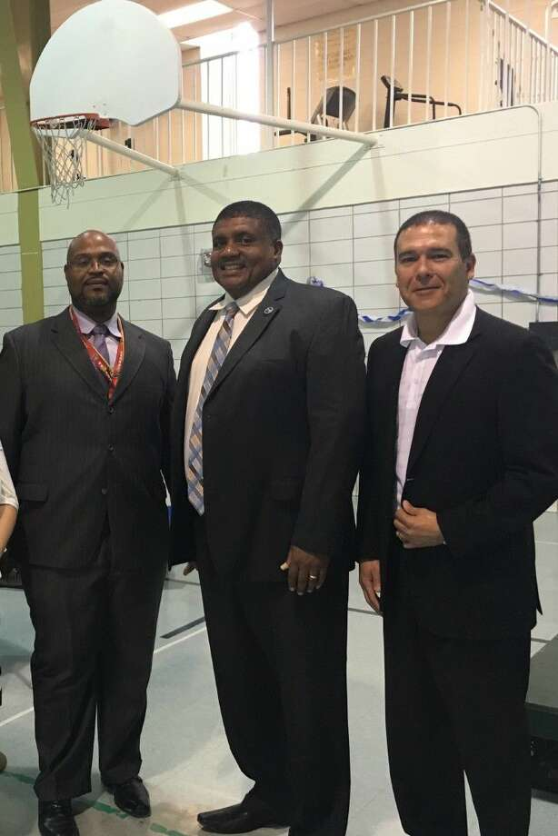 Pictured, from left to right, are Karl McLean, Asst. Superintendent of Youth Village - HCJPD; Dr. Everette Penn, Director of TAPS and Russell Ybarra, President and CEO of Gringo's Mexican Kitchen.