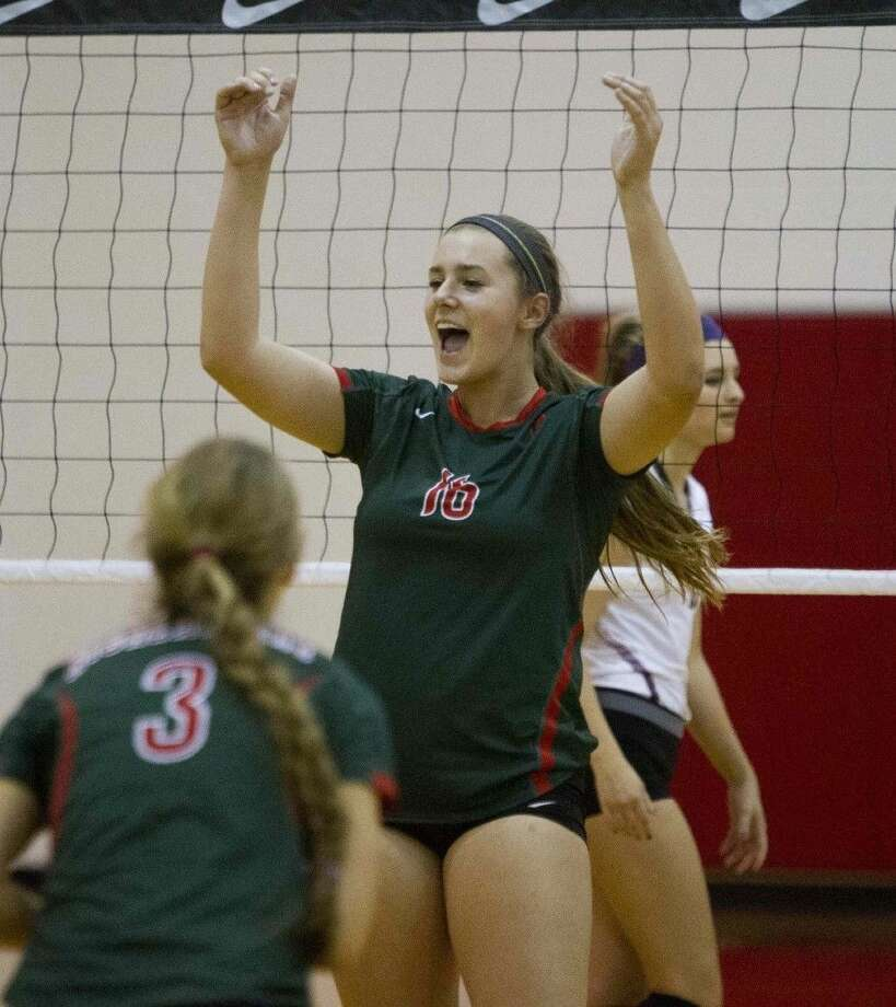 The Woodlands' A.J. Koele celebrates a point during the 2015 Cy-Fair/Katy Nike Invitational semifinals. The Lady Highlanders are the defending tournament champions. Photo: Jason Fochtman