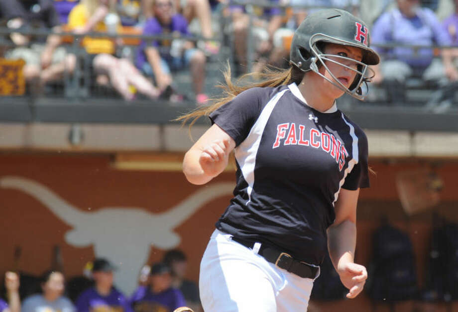 Huffman's Megan Mitchell rounds first base after hitting a single against La Grange in the UIL Class 3A state softball semifinals at Red & Charline McCombs Field in Austin on Thursday. Photo: Keith MacPherson