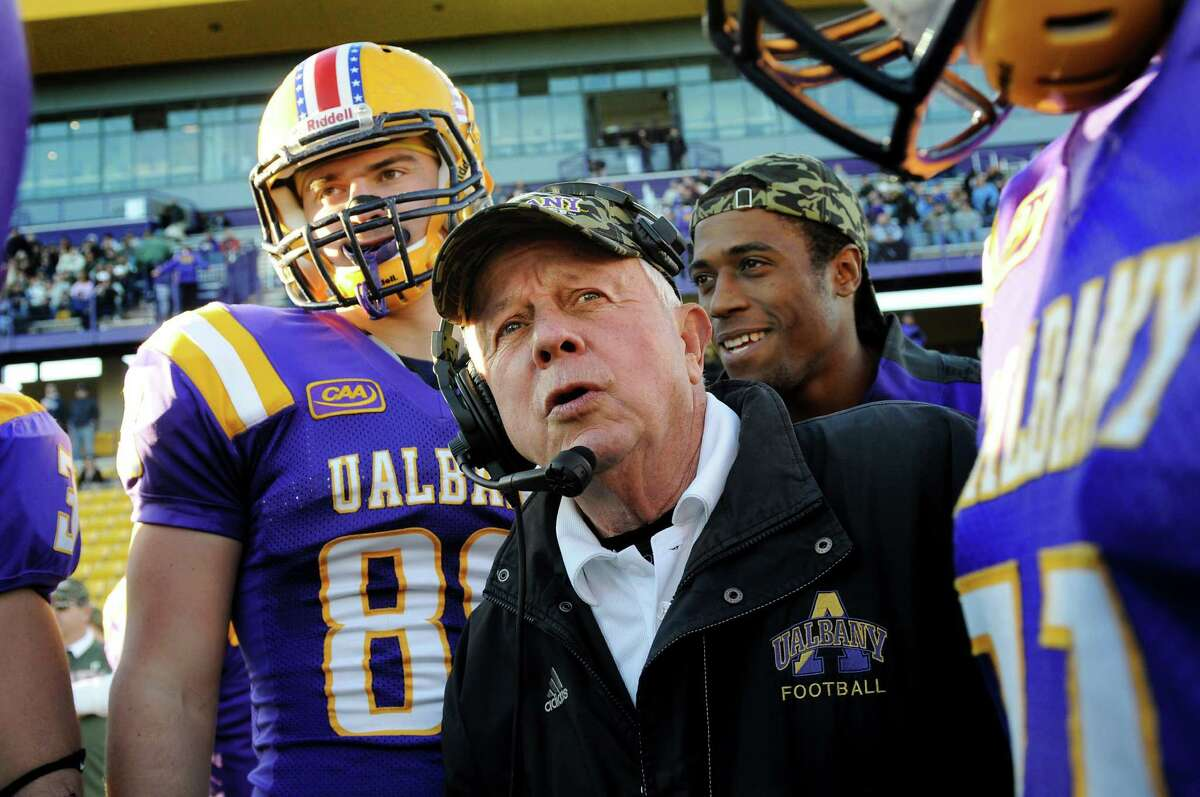 UAlbany coach Bob Ford, center, huddles with his team before the start of their football game against New Hampshire on Saturday, Nov. 16, 2013, at UAlbany's Ford Field in Albany, N.Y. This is Ford's last home game before he retires at the end of the season. (Cindy Schultz / Times Union)