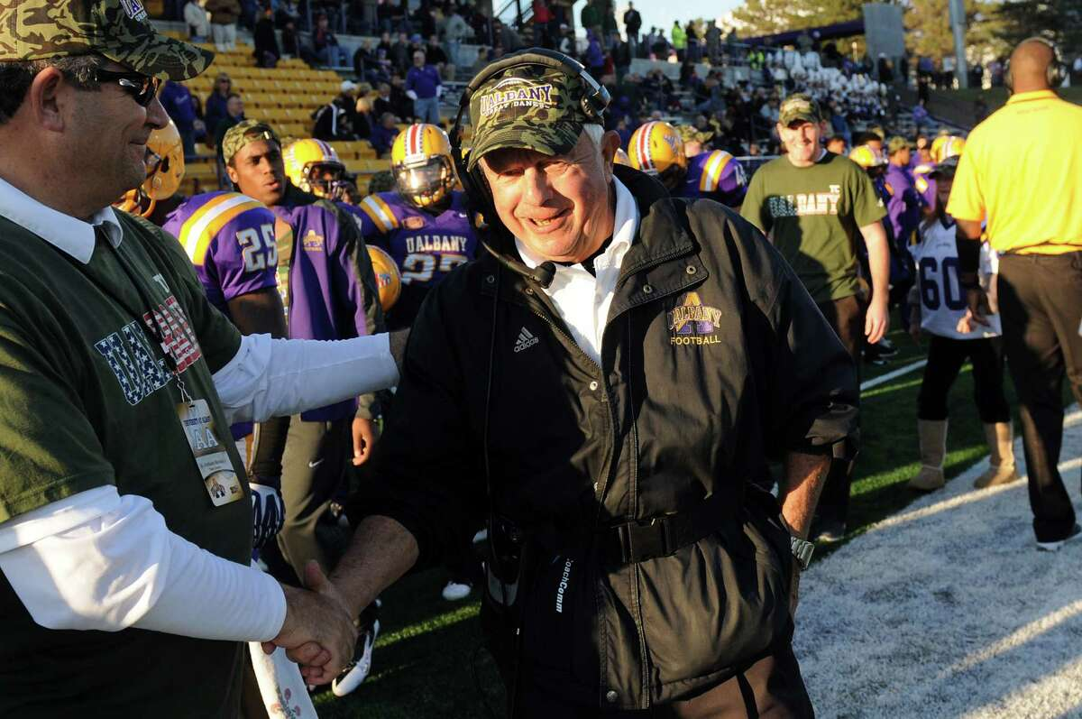 UAlbany coach Bob Ford, center, takes his place on the sideline before their football game against New Hampshire on Saturday, Nov. 16, 2013, at UAlbany's Ford Field in Albany, N.Y. This is Ford's last home game before he retires at the end of the season. (Cindy Schultz / Times Union)