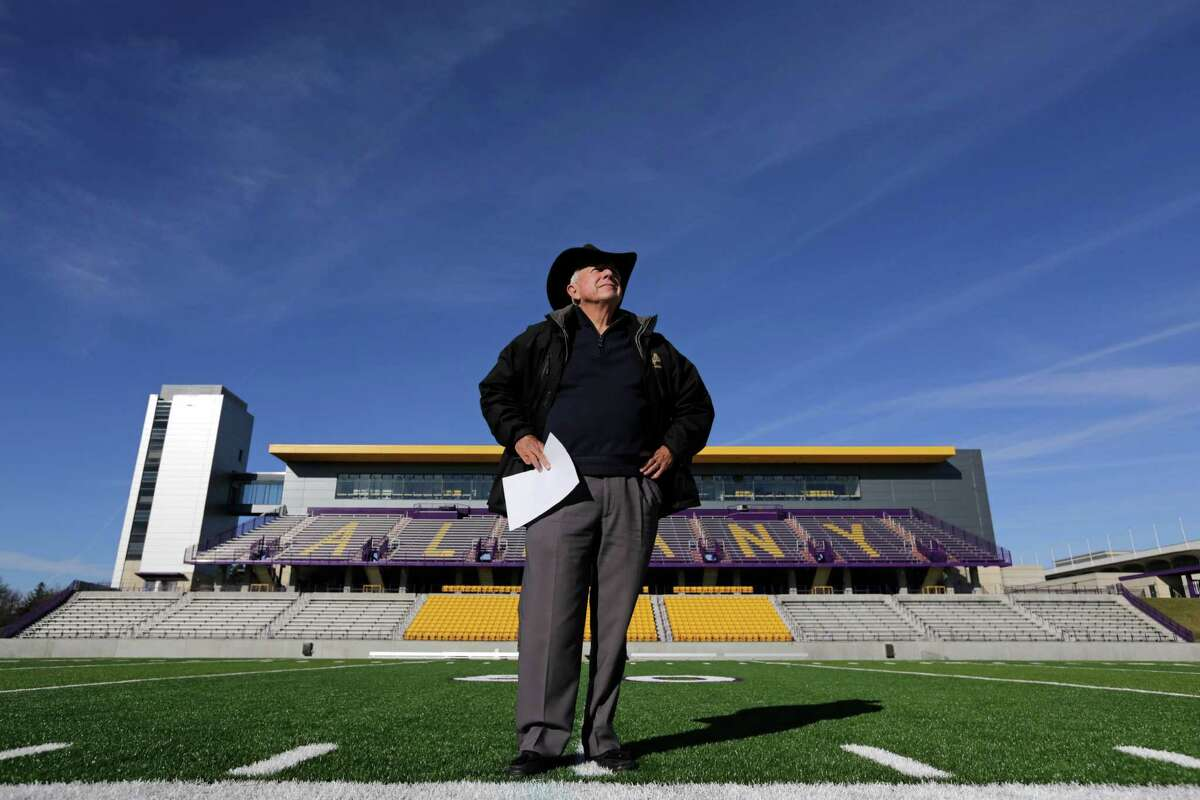 Retiring University at Albany head football coach Bob Ford poses on the field that bears his name on Wednesday, Nov. 20, 2013, in Albany, N.Y. The 76-year-old Ford ranks first among active FCS coaches with 265 career victories and fourth all-time. And the school believes he?'s the only coach to take a team from the club level to Div. III, Div. II, and Div. I at one institution. (AP Photo/Mike Groll) ORG XMIT: NYMG204