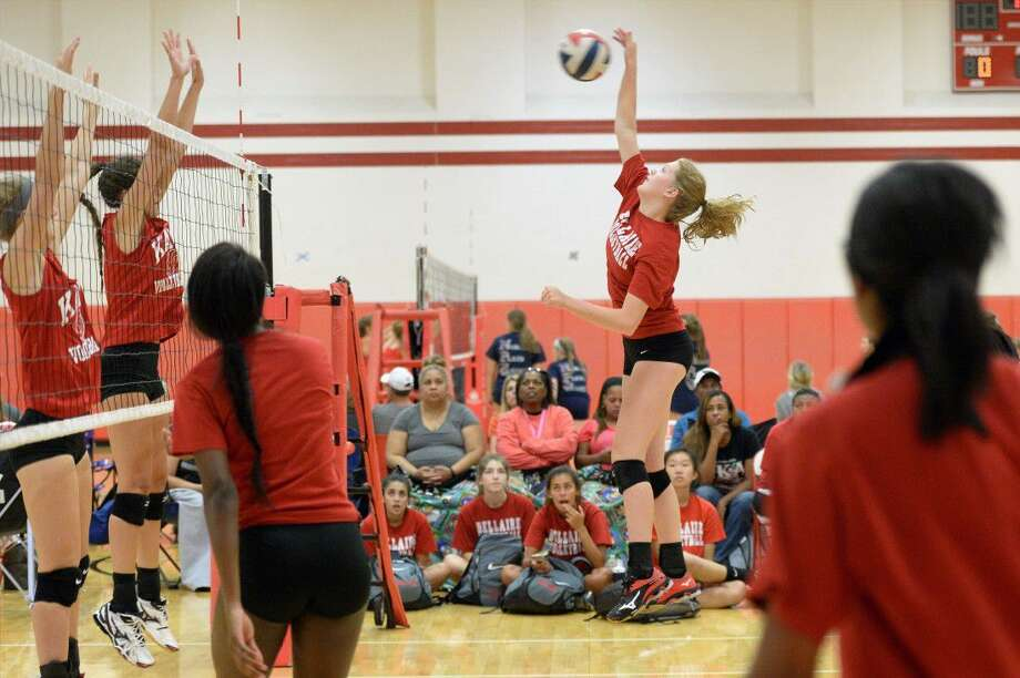 The Bellaire volleyball team plays Katy during a four-team scrimmage Aug. 6 at Katy High School. The Lady Cardinals begin the regular season at home Aug. 9 against Memorial and Fort Bend Austin. View this and additional photos on HCNPics.com. Photo: Craig Moseley