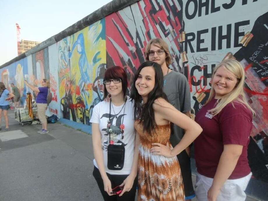Savannah Litton, Ashley Melchor, Joe Litton and Alex Hail stand next to the Berlin Wall during a recent trip to Europe. Photo: Submitted Photo