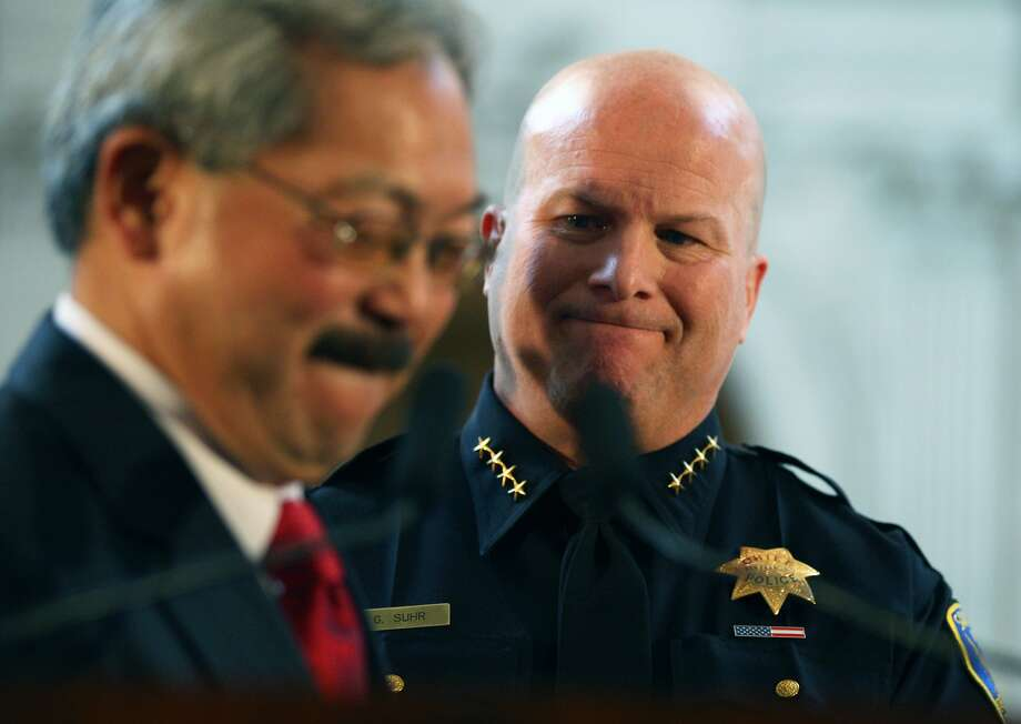 San Francisco Mayor Ed Lee left, steps up to the podium for some closing remarks after swearing in Greg Suhr as the new chief of police for SFPD at San Francisco City Hall Wednesday, April 27, 2011. Photo: Lance Iversen, The Chronicle