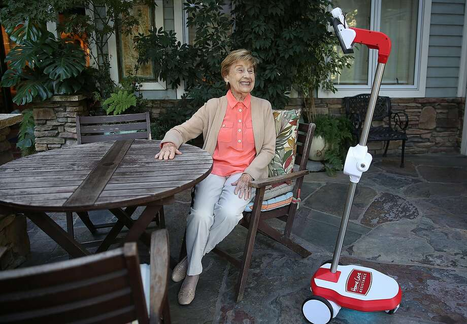 Lou Fleming, 90, speaks to OhmniLabs co-founder Jared Go on the monitor of a robot at a Walnut Creek senior living home. Photo: Liz Hafalia, The Chronicle