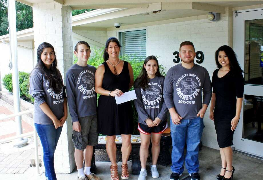 AHS orchestra students recently met with The Village representatives to present them with a $5,300 check which will greatly benefit the nonprofit.