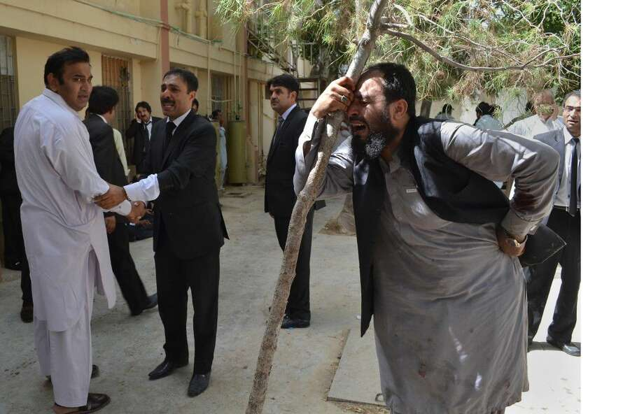 Pakistani lawyers mourn the deaths of their colleagues following a bomb blast in Quetta, Pakistan, Monday. A powerful bomb went off inside a government-run hospital in the southwestern city of Quetta on Monday, killing dozens of people and wounding dozens of others, police said.