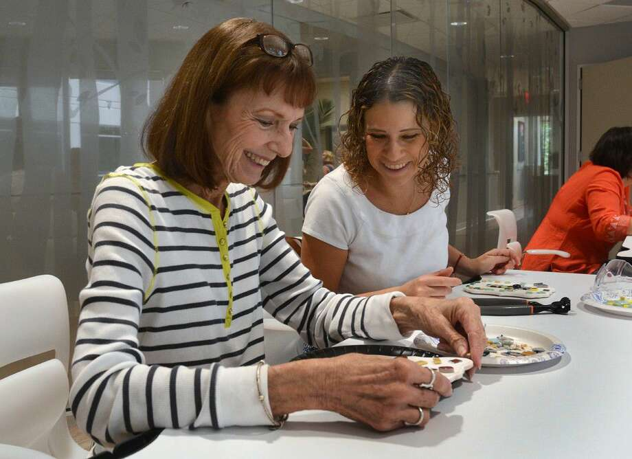 Sylvia Serpas of The Woodlands makes a mosaic design in an art class at the Canopy Cancer Survivorship Center at Memorial Hermann The Woodlands Hospital as another participant watches.