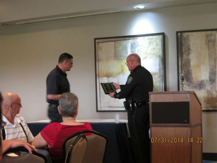 The Deer Park Police Department gave Lt. Earl Morrison (left) a retirement party as he accepts his new position as Chief in Hutto, Texas. Chief Griggs (Right) shows his appreciation by giving Morrison a plaque at the Battleground Golf Course on July 31.