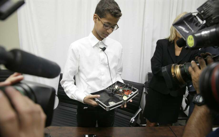 Ahmed Mohamed shows the clock he built in a school pencil box to reporters after a news conference in Dallas, Monday. The family of Ahmed Mohamed, who was arrested after bringing the homemade clock to school, and charged with having a hoax bomb, filed a federal lawsuit Monday against Texas school officials and others, saying they violated the 14-year-old boy's civil rights.