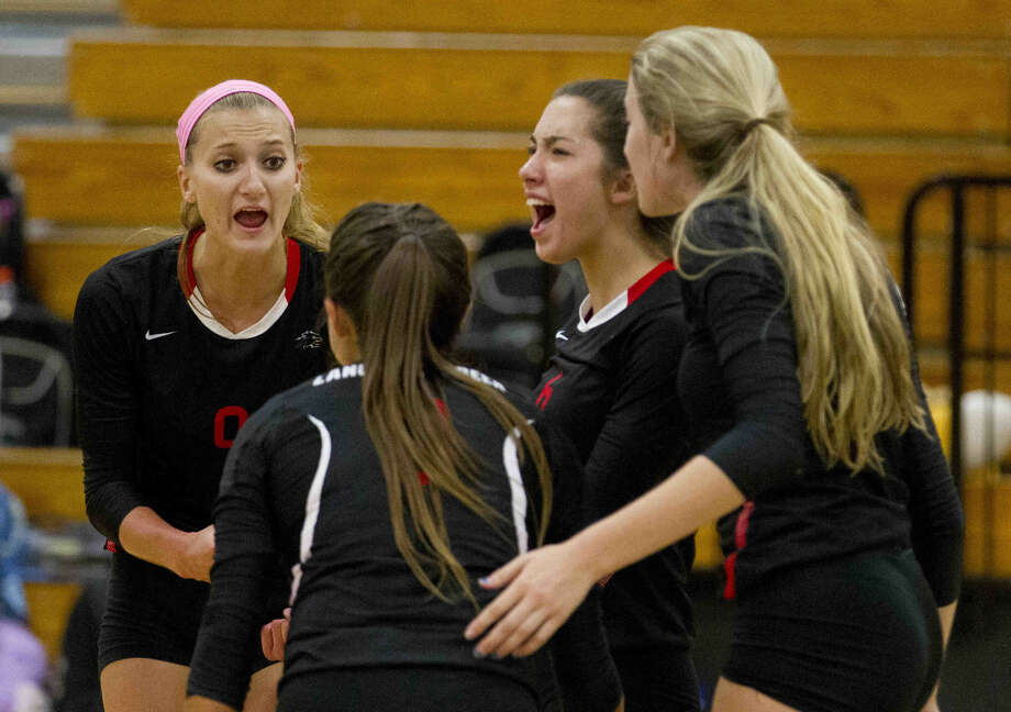 Langham Creek's Janna Skinner, center, celebrates a point in the third set of a volleyball match during the Katy/Cy-Fair Nike Invitational Saturday. Langham Creek secured fifth place in the tournament with a convincing win against Montgomery. Go to HCNpics.com to purchase this photo and others like it. Photo: Jason Fochtman