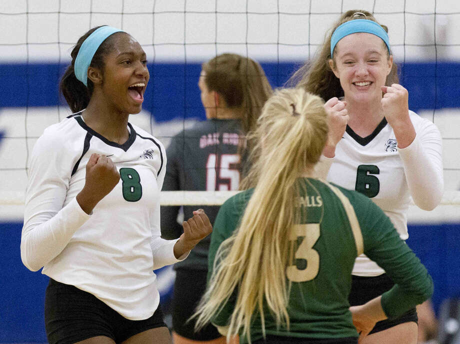 "Cypress Falls' Yossiana Pressley (8) and Alyssa Deloney (6) celebrate a point in the first set of the gold bracket championship volleyball match during the Katy/Cy-Fair Nike Invitational Saturday. Deloney and Pressley were honored as an All-Tournament selection and ""Most Outstanding Hitter,"" respectively. Go to HCNpics.com to purchase this photo and others like it. Photo: Jason Fochtman"