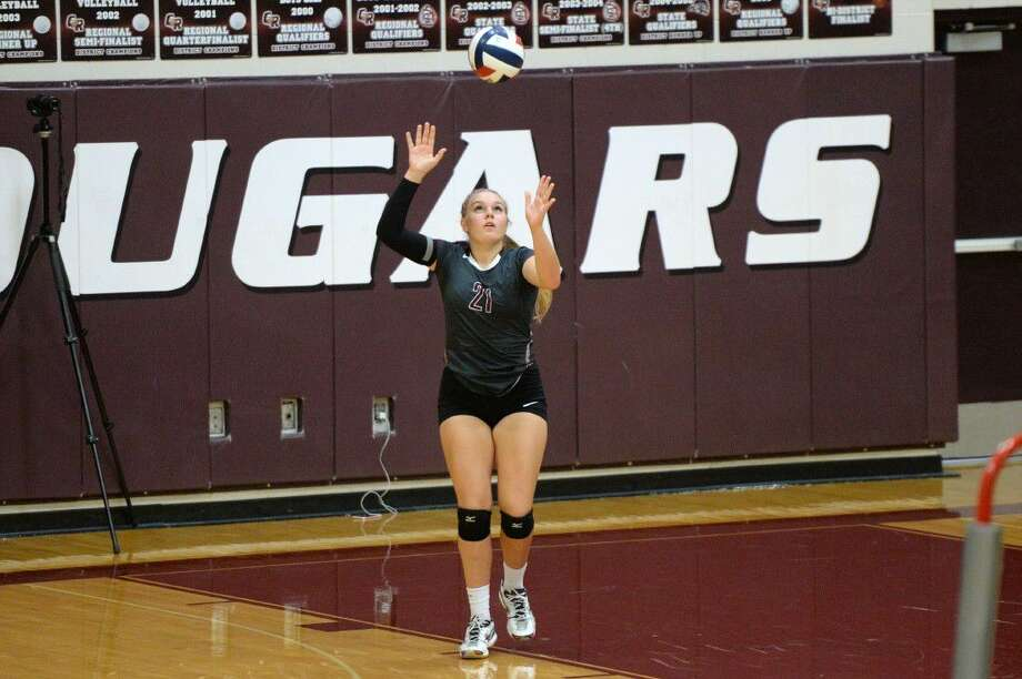 Cinco Ranch's Audrey Parker serves against Bryan during the 2016 Nike Volleyball Classic. The Lady Cougars won their first four matches and finished seventh overall. View additional photos at HCNPics.com. Photo: Craig Moseley