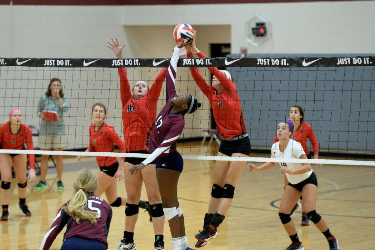 Tompkins' Kailyn O'Neal plays a ball at the net against The Woodlands during the 2016 Nike Volleyball Classic. The Lady Falcons forced three games against the eventual semifinalist. View additional photos at HCNPics.com.