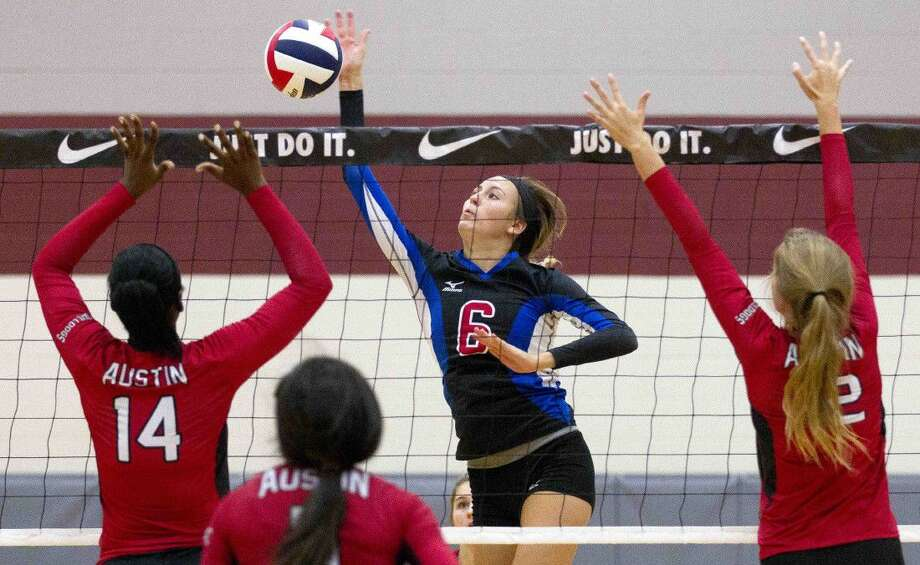 Oak Ridge's Molly Russell gets a shot past the Fort Bend Austin defense in the first set of a volleyball match during the Katy/Cy-Fair Nike Invitational Friday. Go to HCNpics.com to purchase this photo and others like it.