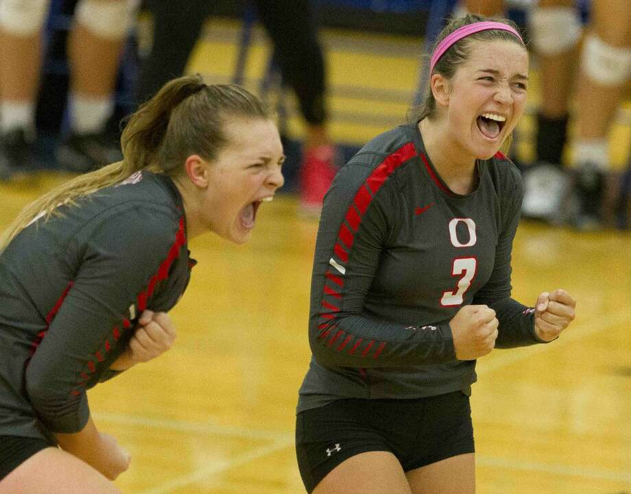 Oak Ridge's Shae Green, right, and Hailey Lohnes celebrate a point in the third set of a Gold Bracket semifinal volleyball match during the Katy/Cy-Fair Nike Invitational Saturday. Go to HCNpics.com to purchase this photo and others like it.