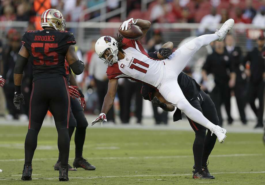 Arizona Cardinals wide receiver Larry Fitzgerald (11) is tackled by San Francisco 49ers linebacker Michael Wilhoite during the first half of an NFL football game in Santa Clara, Calif., Thursday, Oct. 6, 2016. Photo: Ben Margot, Associated Press