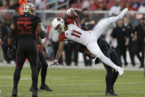 Arizona Cardinals wide receiver Larry Fitzgerald (11) is tackled by San Francisco 49ers linebacker Michael Wilhoite during the first half of an NFL football game in Santa Clara, Calif., Thursday, Oct. 6, 2016. (AP Photo/Ben Margot)