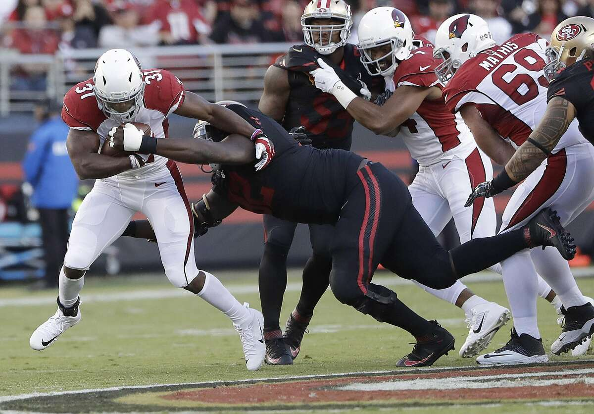 Arizona Cardinals running back David Johnson (31) is tackled by San Francisco 49ers defensive end Quinton Dial during the first half of an NFL football game in Santa Clara, Calif., Thursday, Oct. 6, 2016. (AP Photo/Marcio Jose Sanchez)