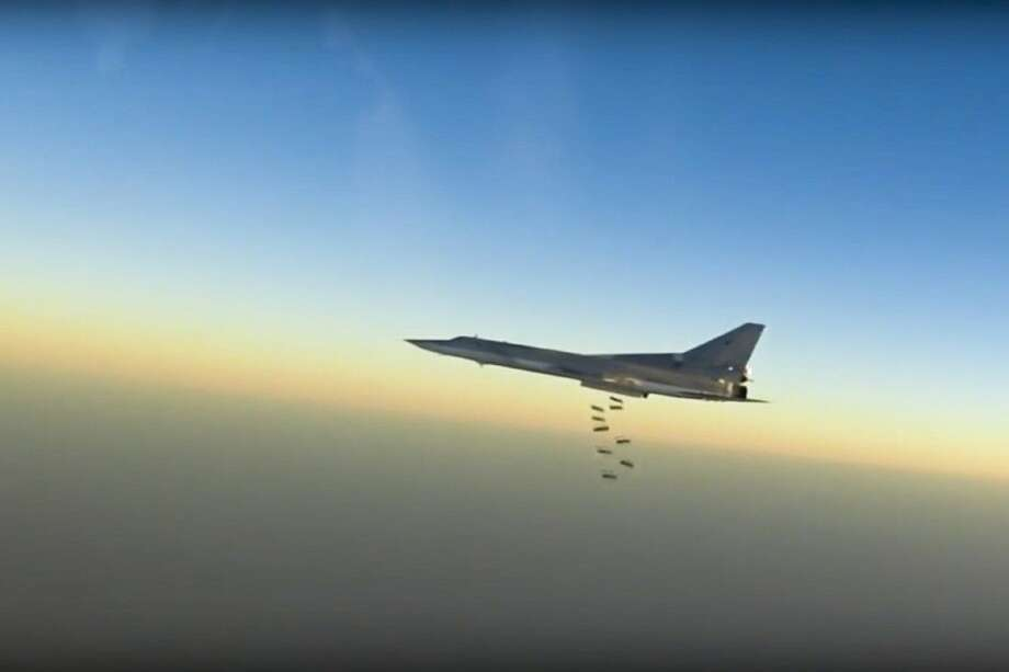 A Russian long range bomber Tu-22M3 flies during a strike above an undisclosed location in Syria on Sunday.