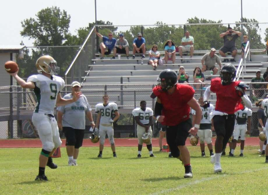Two of the Coldspring-Oakhurst Trojans (right) move in to intercept a Little Cypress-Mauriceville Bear before he can pass the ball. Photo: Jacob McAdams