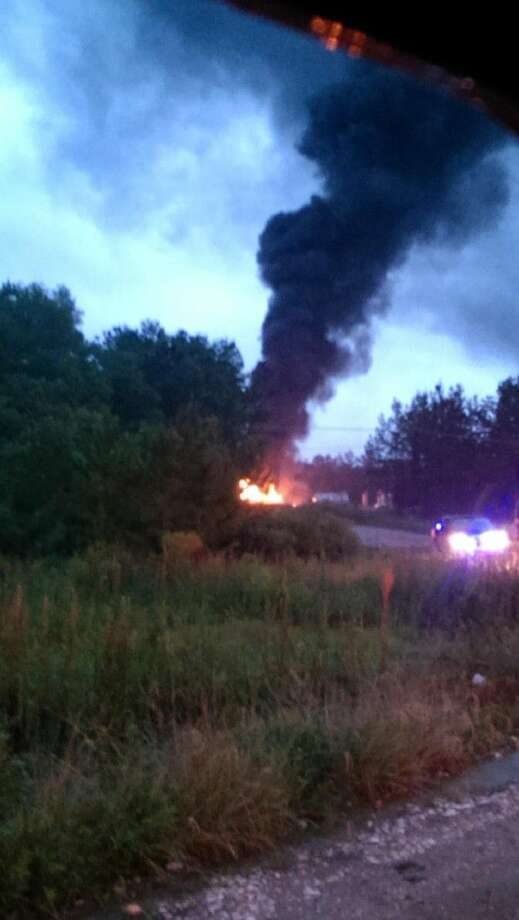 A lightning strike during Saturday evening's storm started a tank fire in Daisetta. Photo: Submitted