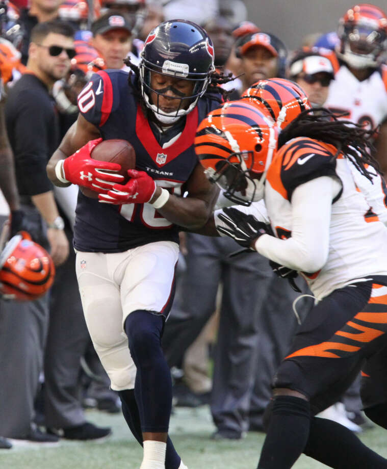 Houston Texans DeAndre Hopkins gets pushed out of bounds against the Cincinnati Bengals at NRG Stadium in Houston, Texas on Sunday, November 23, 2014. Photo: Staff Photo By Alan Warren