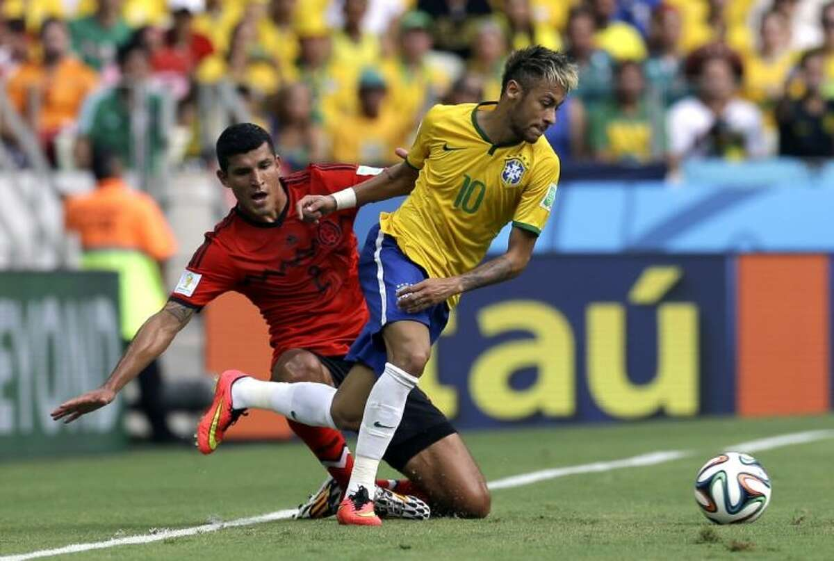 Brazil's Neymar gets away from Mexico's Francisco Rodriguez during a Group A World Cup match on Tuesday at Arena Castelao in Fortaleza, Brazil.