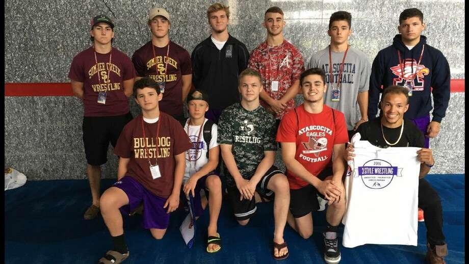 During the school wrestling season these athletes wrestlers fiercely represent their school on the mat, but outside school they train and compete together in club wrestling freestyle and Greco season at 3 Style Wrestling in Atascocita with Coach Derrick Waldroup, a former Olympian. ). Front row from left: Seth Durham (SCHS), Irisch Prochaska (QECHS), Nate Sandquist (KPHS), Dillon Mouser (AHS), Coach Devon Jackson. Back row from left: Nathan Schutt (SCHS), Logan Leatherwood (SCHS), Matt Dean (KHS), Hunter White (AHS), Joshua Escobedo (AHS), Pedro Villarreal (AHS