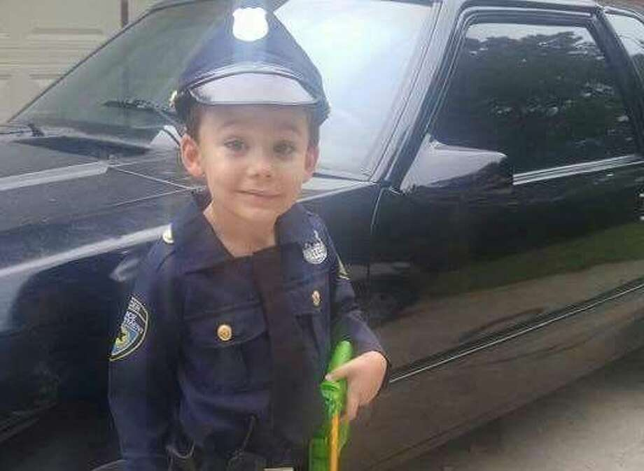 Five-year-old Adoniah Costa poses in his police uniform. Adoniah was saved by his mother, Samantha Costa, after he nearly drowned in a neighbor's pool in Roman Forest Tuesday, Aug. 9.