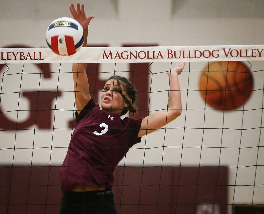 Magnolia's Ally Meyers hits the ball during a high school volleyball game against Montgomery on Tuesday, Aug. 9.