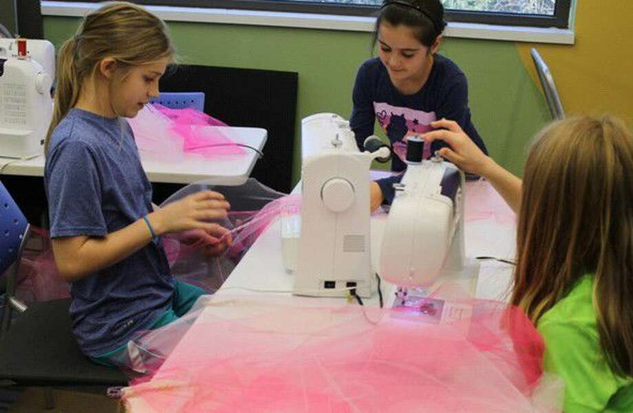 Girls strengthen their textile skills through sewing during a Creativity Shell class. Creativity Shell will be opening a makerspace in Kingwood in September.