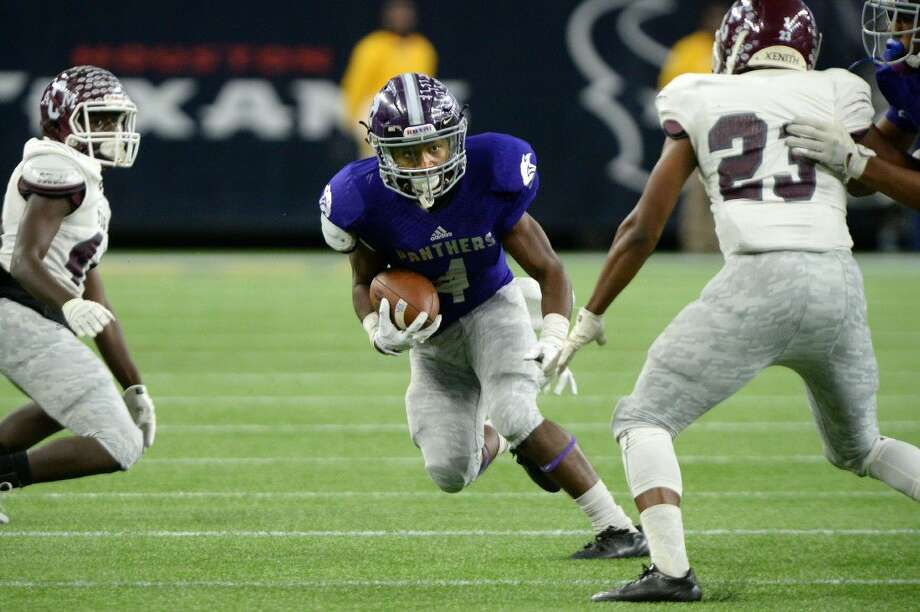 Ridge Point's B.J. Rainford rushes against A&M Consolidated during their 2015 regional semifinal at NRG Stadium in Houston. Rainford was selected for the Touchdown Club of Houston UIL preseason team. For more information, go to page 7A of today's edition of your Sugar Land Sun. To view or purchase this photo and others like it, visit HCNpics.com. Photo: Craig Moseley