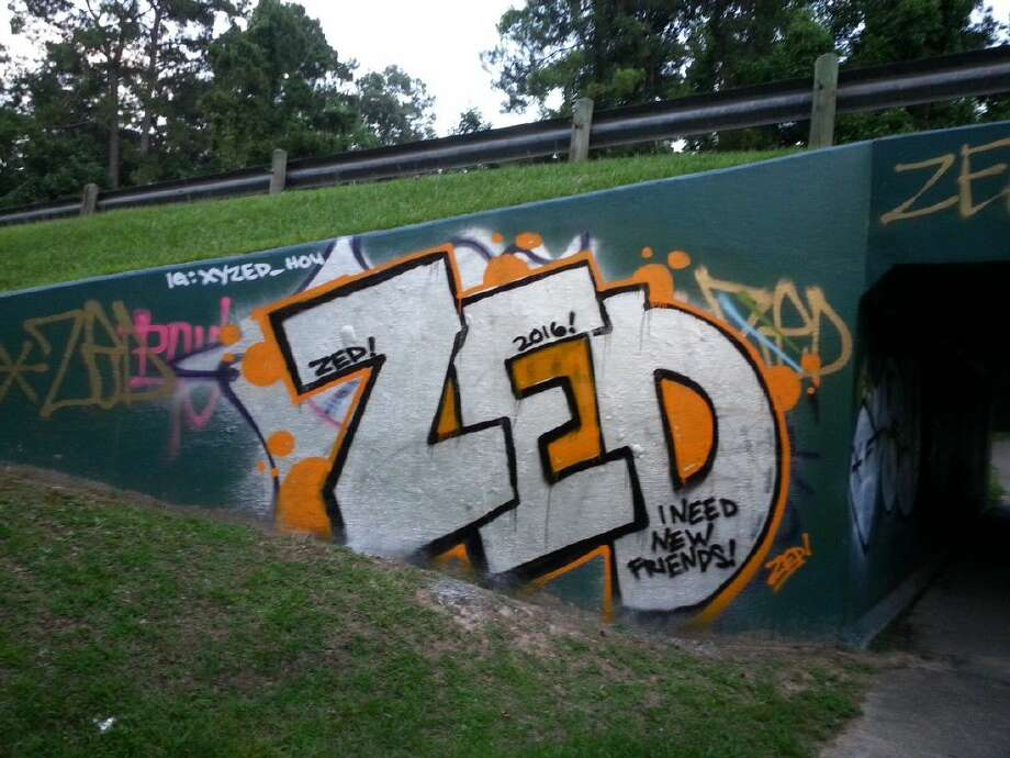 "The graffiti, oftentimes reading, ""Zed,"" appeared on a business on Loop 494, one of the pedestrian underpasses in the Bear Branch subdivision area and along the wall of the High Occupancy Vehicle lane entrance ramp along U.S. Highway 59 in Humble."