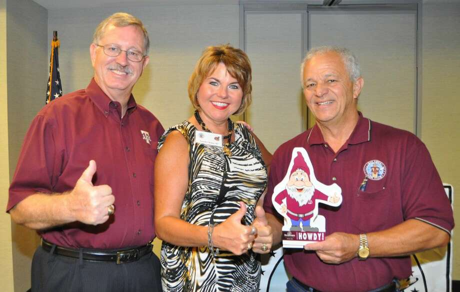 Enjoying the Bay Area A&M Club meeting are pictured from left, Mike Cade, Jennifer Bohac, speaker and Joe Camarata.
